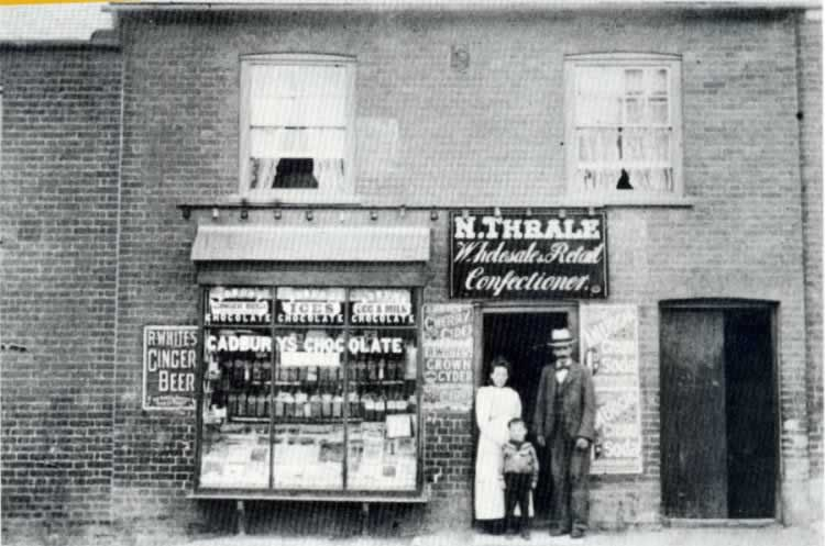 Norman Thrale, Hannah Thrale (nee Green) and their son Norman Thrale (1896-1908) outside their London Road, St Albans shop circa 1898.